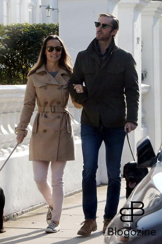 EXCLUSIVE ALL ROUNDER ***NO WEB WITHOUT APPROVAL FROM VANTAGE NEWS - NO SUBSCRIPTIONS*** Pippa Middleton and James Matthews take their dogs for a walk in the autumnal sunshine. The recently engaged couple looked completely loved-up as they shared a joke during their stroll through the streets of central London. 23 October 2016. Please byline: Vantagenews.com