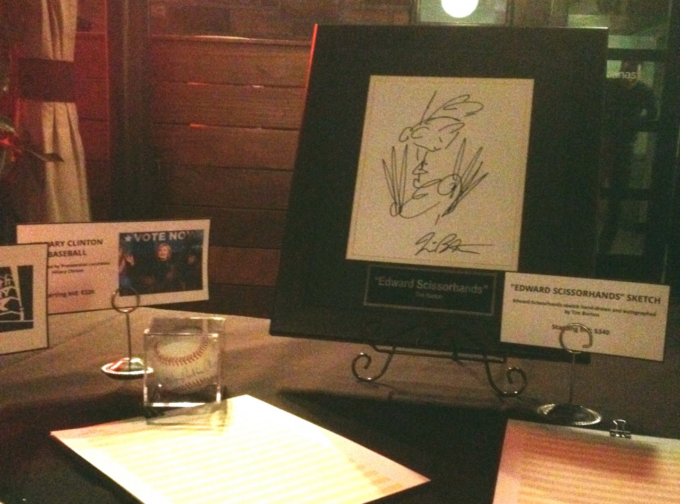 Some of the items you could get at the silent auction: a baseball signed by Hillary Clinton and a drawing of Edward Scissorhands by Tim Burton.