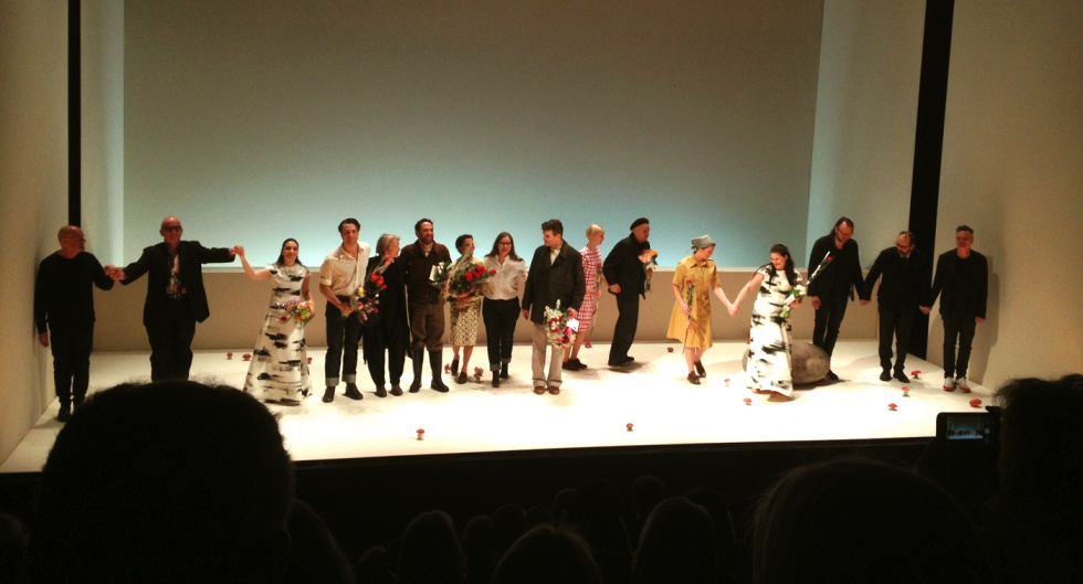 The actors and the creative team on stage after the performance.