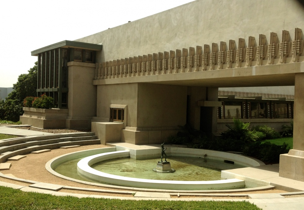 Hollyhock House, designed by Frank Lloyd Wright. with the hollyhock represented on the wall.
