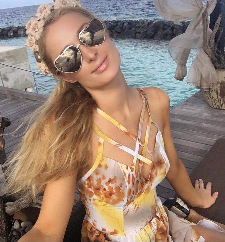 """22-2-2016 Paris Hilton posts a series of swimwear Selfies and writes """"Another beautiful sunny day on the #MagicaI Island. ?? Pictured: Paris Hilton PLANET PHOTOS www.planetphotos.co.uk info@planetphotos.co.uk +44 (0)20 8883 1438"""