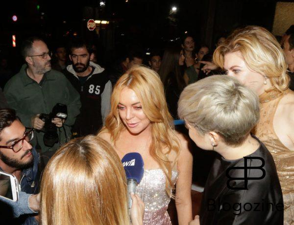 52204278 Lindsay Lohan attends the opening of her new club 'Lohan' in Greece on October 15, 2016.  The grand opening featured people in LED lighted suits, classy dresses and Lindsay Lohan blowing kisses to the camera. The group appeared to be thoroughly enjoying their time out. At one point, Lindsay was being interviewed by a slew of reporters. FameFlynet, Inc - Beverly Hills, CA, USA - +1 (310) 505-9876 RESTRICTIONS APPLY: NO GREECE