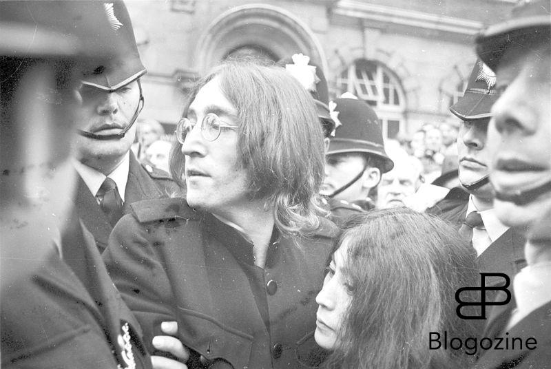 John Lennon protects Yoko Ono after crowds tried to mob them after they left a London Court Hearing Charges of Possession of Marijuana and Obstructing Police. The pair were released on bail of £100 until their trial on 28th November. London - 19th October 1968 Ref: B196_095082_0934 Date: 19.10.1968 Compulsory Credit: STARSTOCK/Photoshot 9th November 1966 - John Lennon and Yoko Ono meet for the first time at her exhibition at the Indica Gallery in London. Lennon remembered the date of their meeting as the 9th but many Beatles historians contend that it actually happened on the 7th, the day before the exhibition opened.
