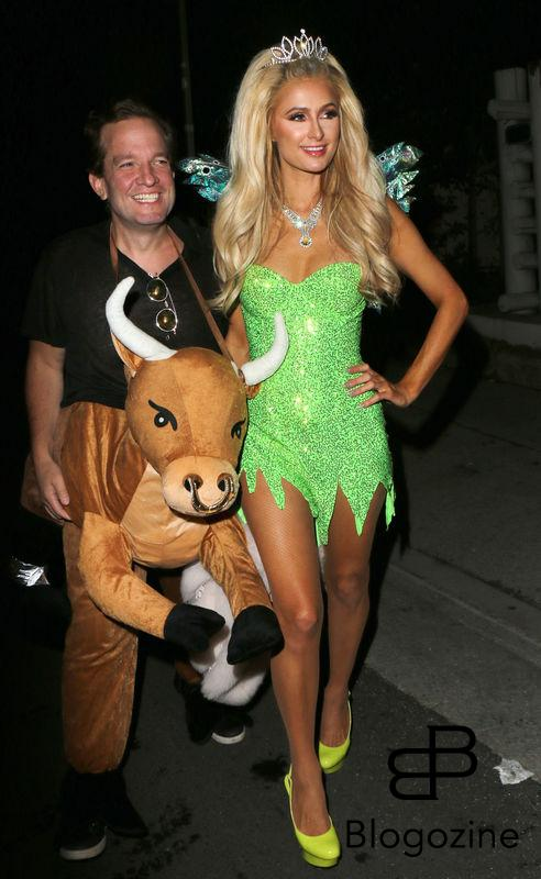 158912, Paris Hilton arrives at Adam Levine's Halloween Party dressed as a lime-green Angel as cowboy Jeff Beacher joins her. Her driver adjusted her wings before she faced the cameras. Los Angeles, California - Monday October 31 2016. Photograph: © MHD, PacificCoastNews. Los Angeles Office (PCN): +1 310.822.0419 UK Office (Photoshot): +44 (0) 20 7421 6000 sales@pacificcoastnews.com FEE MUST BE AGREED PRIOR TO USAGE